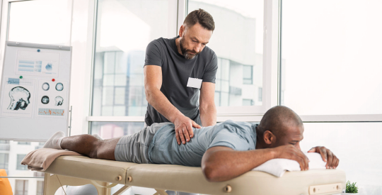 man doing physical therapy of his client